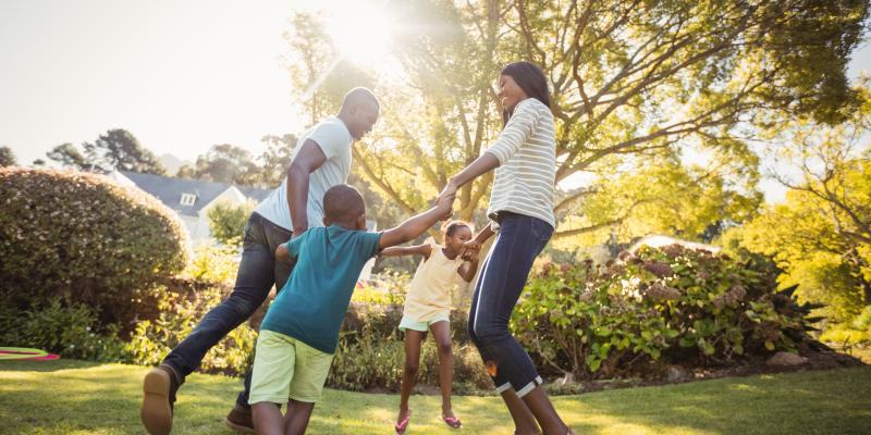 family enjoying their yard